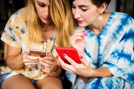 Friends playing games on smart phones together