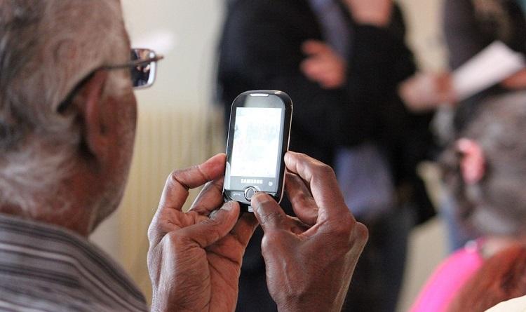 Older man using a smart phone
