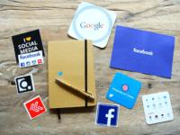 Social media icons near a notebook