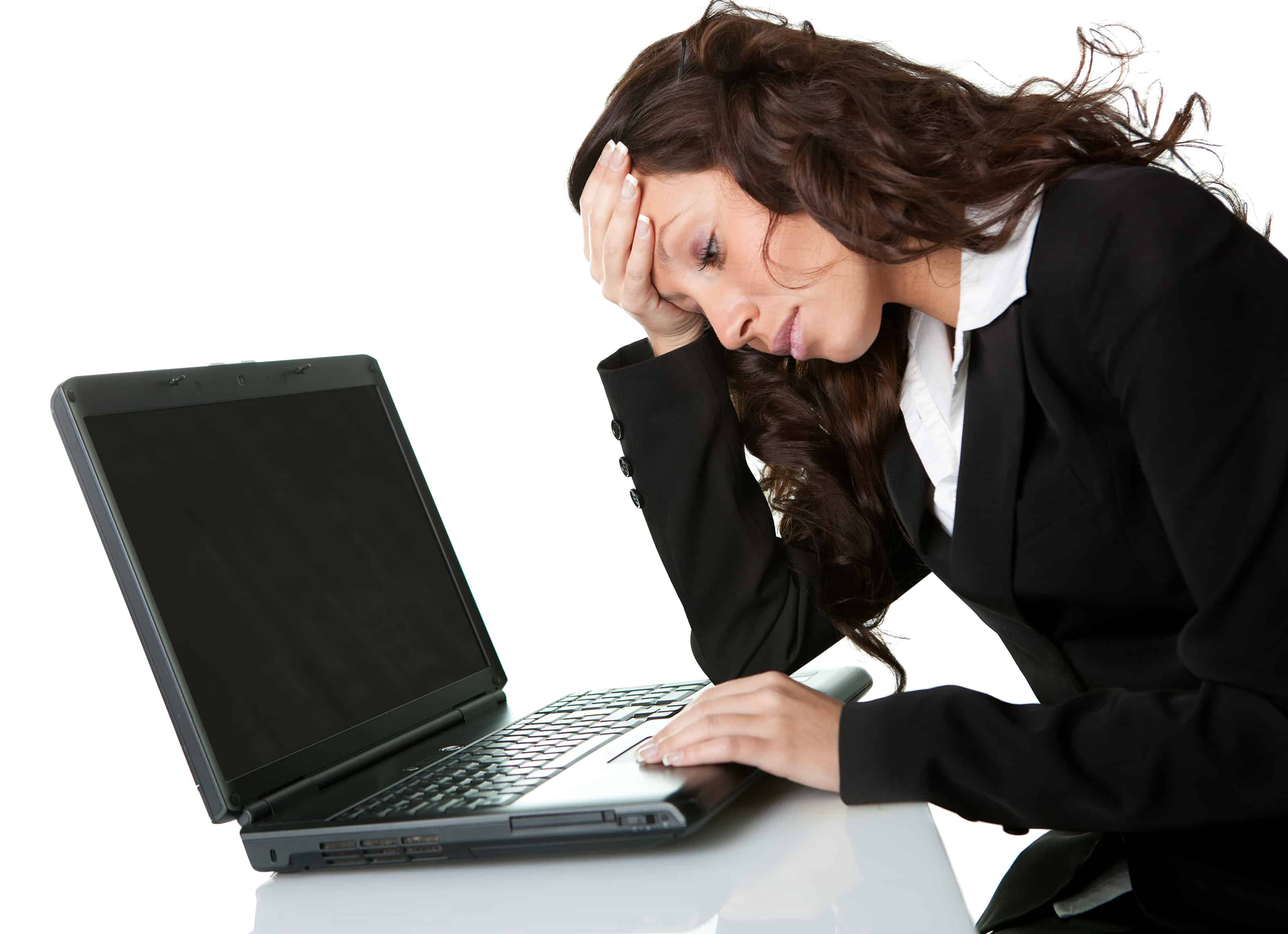 Female businessperson frustrated that her computer won't turn on