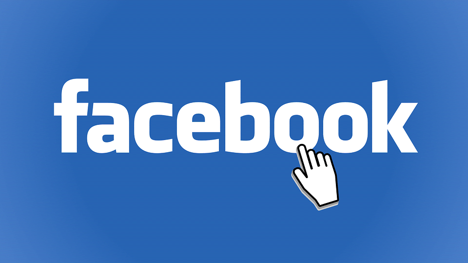 Hand cursor clicking on Facebook logo