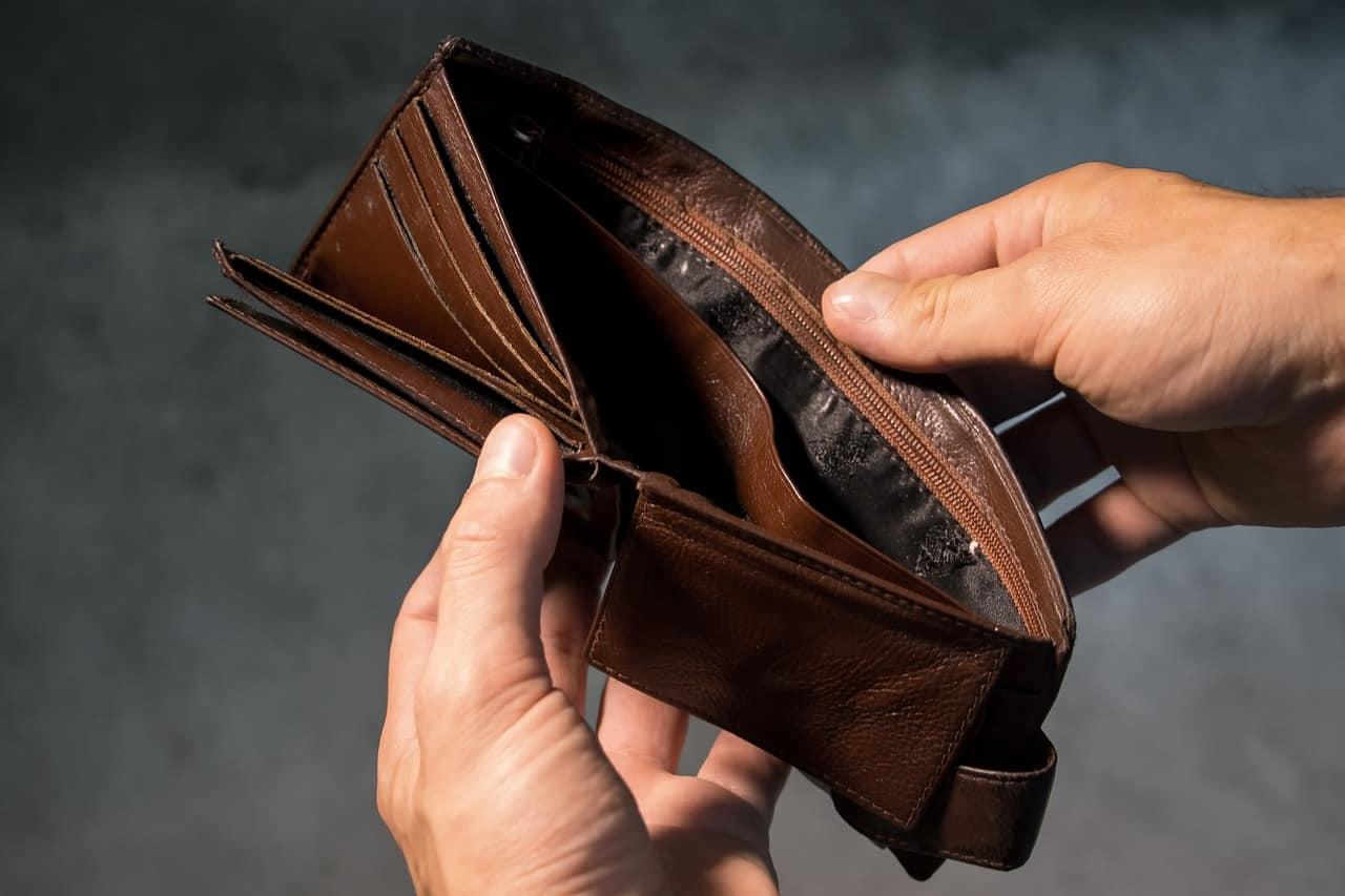 A man holding an empty wallet