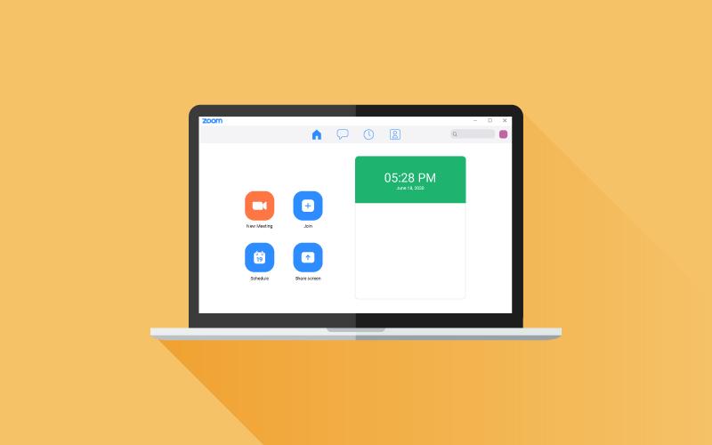 Desktop laptop with Zoom app screen