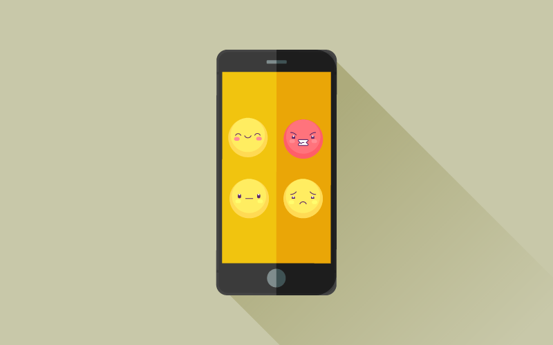 A smartphone screen with multiple emojis conveying different emotions