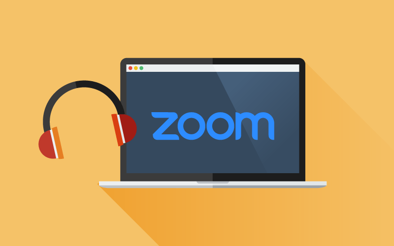 A graphic of a laptop displaying the Zoom logo with headphones next to it