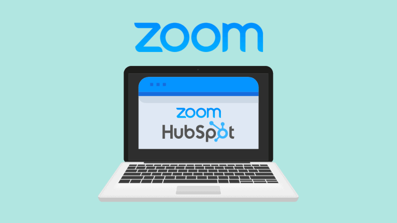 Laptop displaying Zoom and HubSpot logos