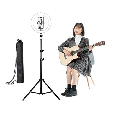 Girl performing with a guitar with Yuepin 10.2 inch ring light, stand, and phone