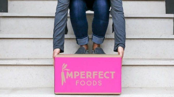 man picking up imperfect food box