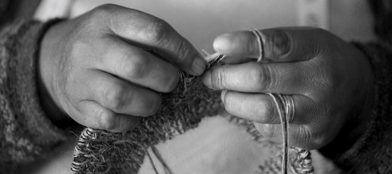 black and white knitting hands