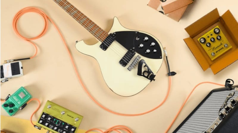 white electric guitar with other music accessories