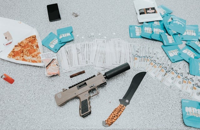 Contraband items such as gun, knife, or drugs