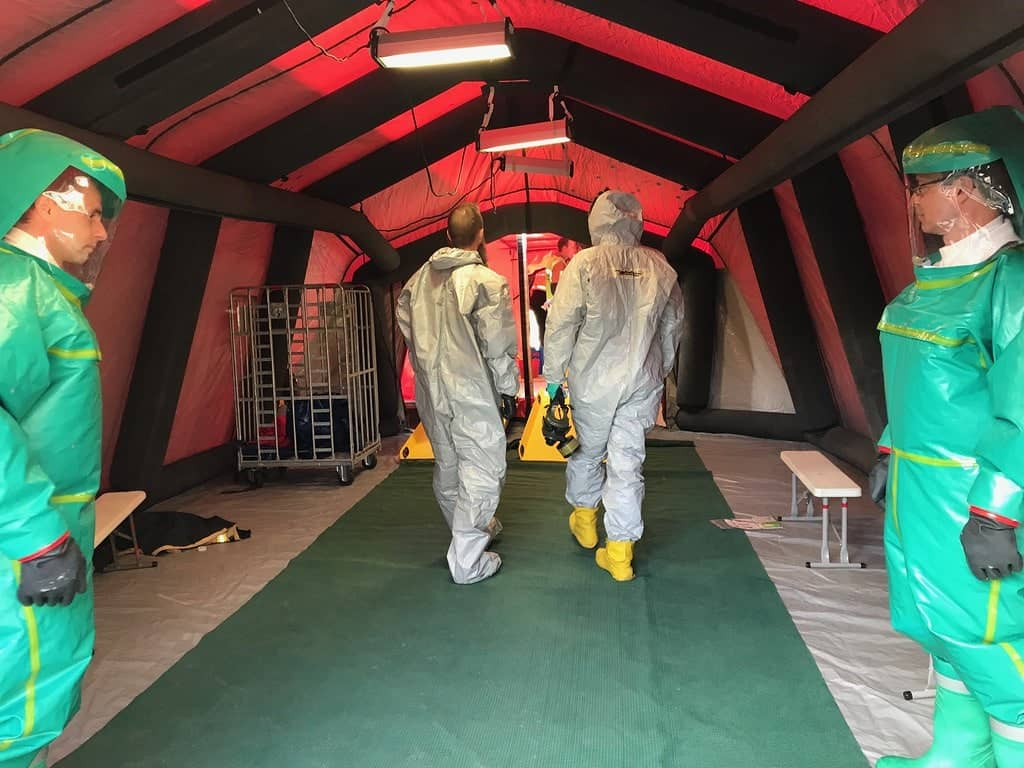 First responders inspecting portable decontamination showers
