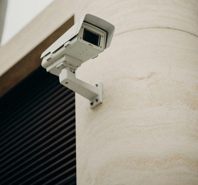A CCTV camera mounted near a garage or loading bay